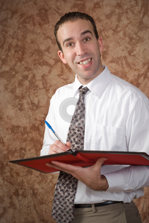 Waiter stock photo, A waiter holding a pen and a binder about to take someone's order by Richard Nelson