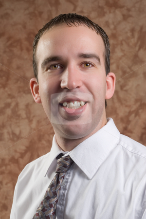 Business Portrait stock photo, Closeup of a young man wearing a shirt and tie, smiling for his portrait by Richard Nelson