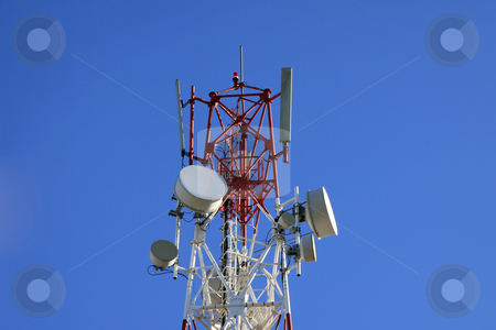 Telecommunication tower. stock photo, Closeup view of telecommunication tower on a blue sky background. by Gowtum Bachoo