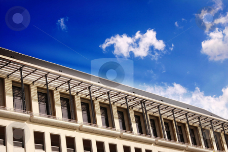 Modern building stock photo, Modern building facing vivid blue cloudy sky by Gowtum Bachoo