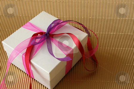 Gift Box stock photo, Gift box with pink, purple and red colored ribbons by Vanessa Van Rensburg