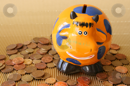 Money Box stock photo, Money box in the shape of an orange cow by Vanessa Van Rensburg