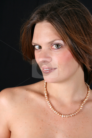 Beautiful Woman stock photo, Beautiful young woman with bare shoulders and pearls by Vanessa Van Rensburg