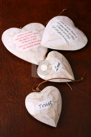 Wooden Hearts stock photo, Wooden heart decorations with words of wisdom by Vanessa Van Rensburg