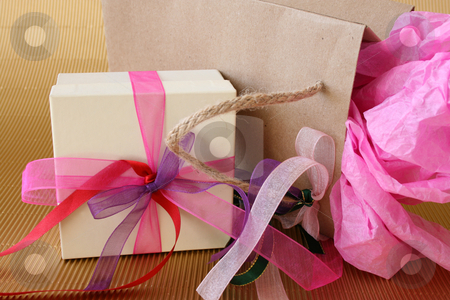 Gifts Box stock photo, Cream colored gift box and brown gift bag with ribbons by Vanessa Van Rensburg