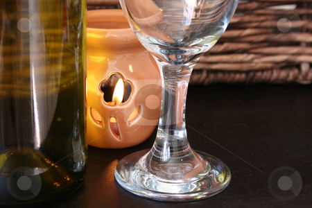Bottle, Glass and Candle stock photo, Wine bottle, Wine glass and a lit candle by Vanessa Van Rensburg