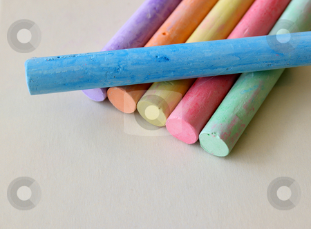 Chalk stock photo, Blackboard chalk in various colors on a cream colored surface by Vanessa Van Rensburg