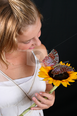 Young Model stock photo, Teenage female model holding a sunflower with a butterfly by Vanessa Van Rensburg
