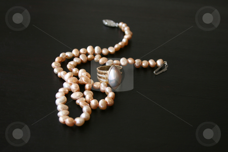 Pearl Jewellery stock photo, Pearl necklace and ring with gold band by Vanessa Van Rensburg