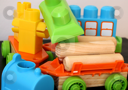 Building Blocks stock photo, Building blocks and cars in different colors by Vanessa Van Rensburg