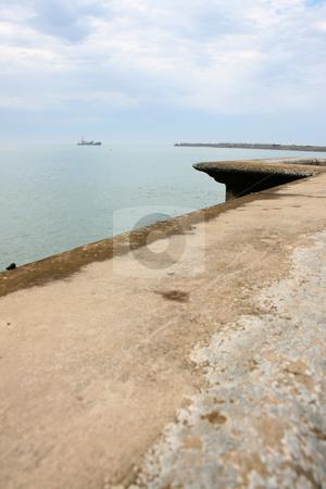 Ship stock photo, A ship far away on the horizon on a cloudy day by Vanessa Van Rensburg