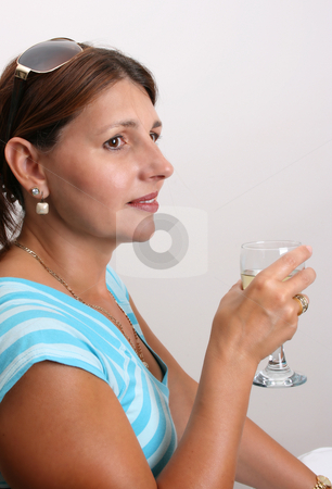 Adult Model stock photo, Adult Female Model wearing a blue top with a glass of wine by Vanessa Van Rensburg