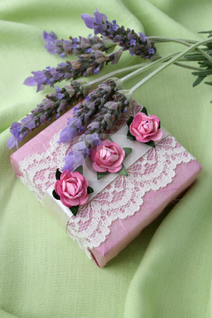Soapy Gifts stock photo, Soap gifts in pink with fresh lavender flowers by Vanessa Van Rensburg