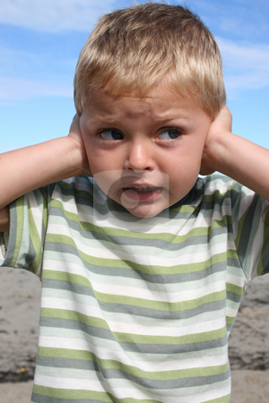 Boy at beach stock photo, Young blond boy at the beach, closing his ears by Vanessa Van Rensburg