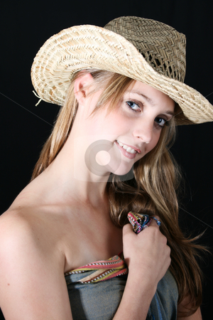 Female Model stock photo, Beautiful female wearing a straw hat, against a black background by Vanessa Van Rensburg