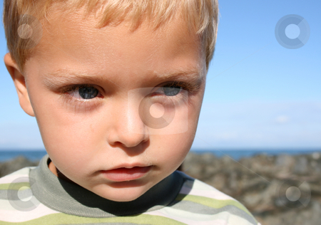 Boy at beach stock photo, Young blond boy at the beach, looking into the distance by Vanessa Van Rensburg