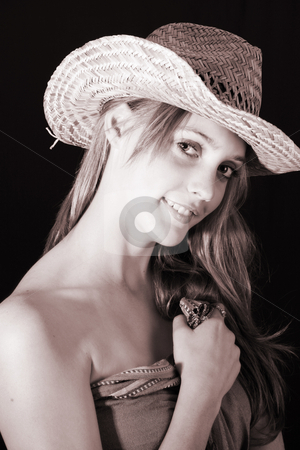 Female Model stock photo, Beautiful young model wearing a straw hat and a fabric wrap by Vanessa Van Rensburg