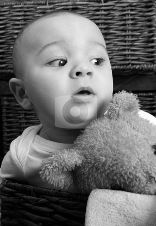 Baby Boy stock photo, Six month old baby sitting infront of wooden drawers by Vanessa Van Rensburg