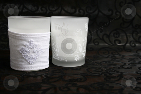 Candles stock photo, Two white glass holders with candles in by Vanessa Van Rensburg