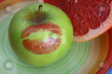 Apple and Pomelo stock photo, Sliced Pomelo and a green apple with a red kiss by Vanessa Van Rensburg