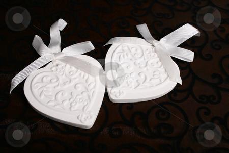 Ceramic Hearts stock photo, White Ceramic hearts with white ribbons tied by Vanessa Van Rensburg