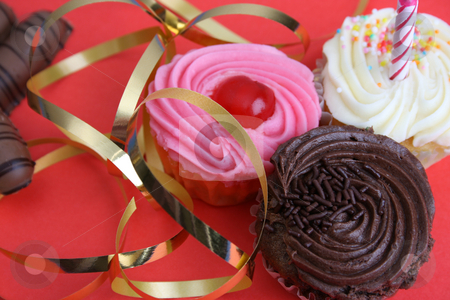 Birthday Cupcake stock photo, Birthday Cupcake with one candle and gold ribbon by Vanessa Van Rensburg
