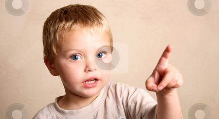 Blond Child stock photo, Beautiful Blond toddler pointing at someting with his hand by Vanessa Van Rensburg