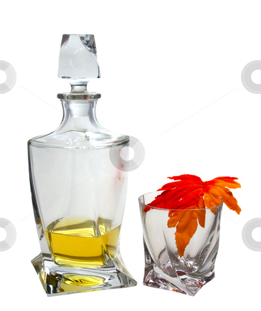 Whisky stock photo, Crystal bottle and glass with light whisky and maple leaf by Fabio Alcini