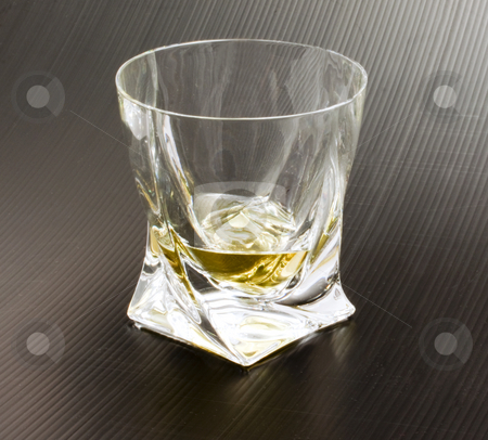 Whisky stock photo, Crystal glass with whisky on black background by Fabio Alcini