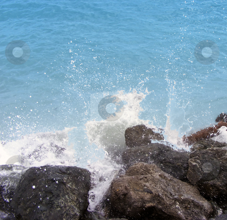 Sea stock photo, Blue sea breaking on the rocks by Fabio Alcini