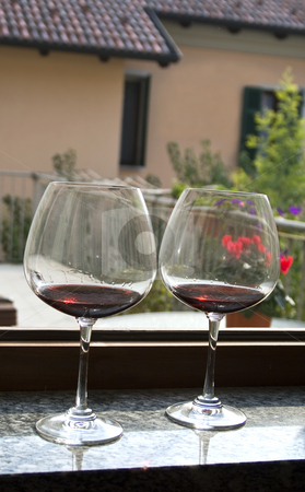 Two glasses stock photo, Two glasses of red wine over an open window by Fabio Alcini