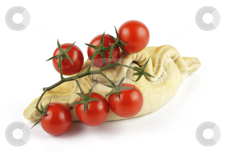 Tomatoes and Pasty stock photo, Contradiction between healthy food and junk food using tomatoes and a pasty on a reflective white background by Keith Wilson