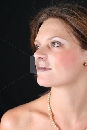 Beautiful Woman stock photo, Beautiful young woman against a black background by Vanessa Van Rensburg