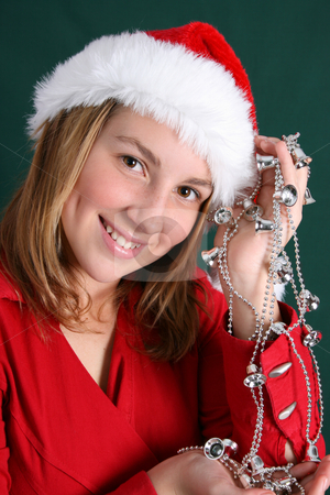 Christmas Bells stock photo, Teenager in red holding a silver string with bells by Vanessa Van Rensburg