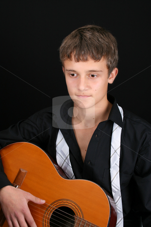 Casual Teen stock photo, Teenage male in casual attire playing guitar by Vanessa Van Rensburg