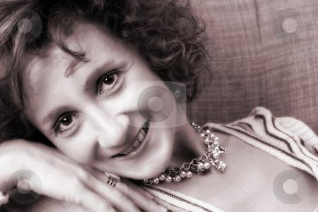 Mature female stock photo, Mature female posing on the sofa wearing jewelery by Vanessa Van Rensburg