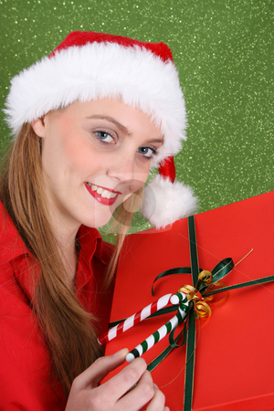 Christmas Present stock photo, Christmas girl holding a red gift box with decorations by Vanessa Van Rensburg