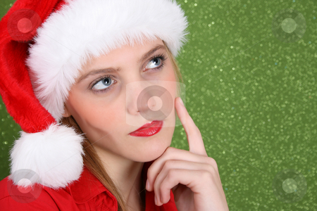 Christmas Thoughts stock photo, Christmas in deep thought wearing a christmas hat by Vanessa Van Rensburg