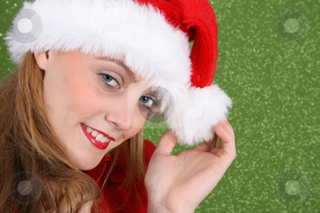 Christmas Smiles stock photo, Female Model with red lips wearing a christmas hat by Vanessa Van Rensburg
