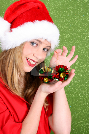 Christmas Teen stock photo, Teenager wearing a christmas hat, holding decorations by Vanessa Van Rensburg