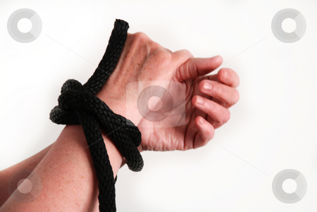 Tied up stock photo, Pictures of the hands of a person tied up with black rope by Albert Lozano