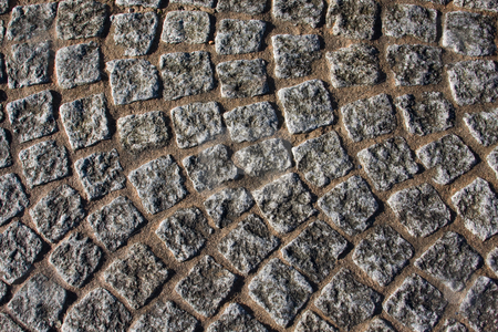 Church cobblestones stock photo, Close up of cobblestones in a churchyard by Darren Pattterson