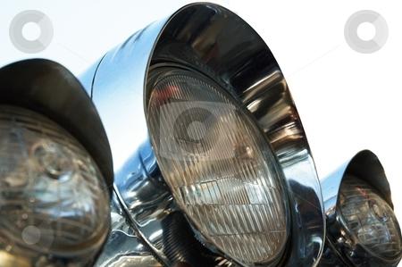 Chromed motorcycle headlights stock photo, Chromed motorcycle headlights. Close-up. Isolated on white. by Oleg Blazhyievskyi