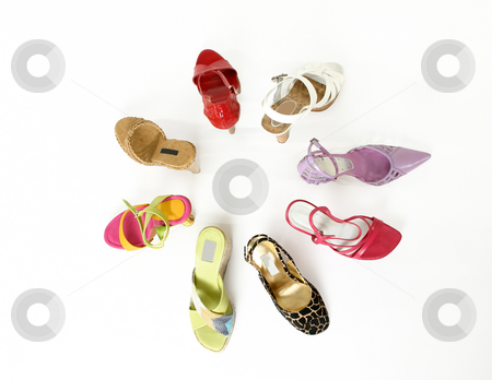 Colour my feet stock photo, Circle of coloured women's shoes by Leah-Anne Thompson