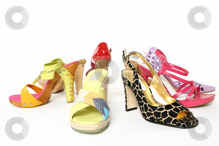 Fashion shoes stock photo, Women's casual and dress sandals and shoes on a white background. by Leah-Anne Thompson