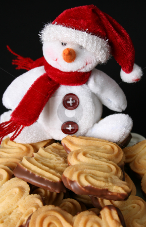 Christmas Cookies stock photo, Christmas cookies with a snowman decoration on a black background by Vanessa Van Rensburg