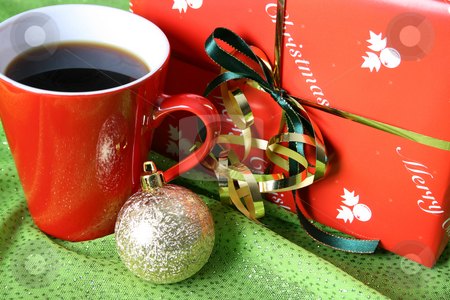 Christmas Day Coffee stock photo, Christmas morning coffee with a gift and decoration by Vanessa Van Rensburg