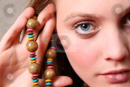 Female Model stock photo, Beautiful female model with blue eyes and a string beads by Vanessa Van Rensburg