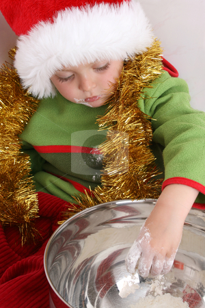 Baking Christmas Cookies stock photo, Toddler wearing a christmas hat, baking christmas cookies by Vanessa Van Rensburg