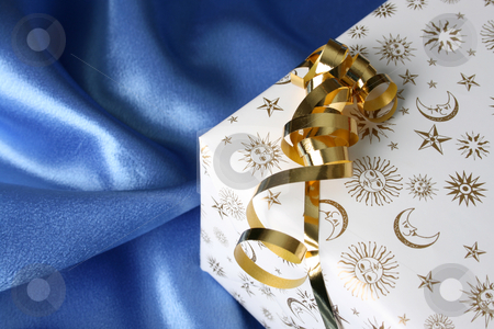 Christmas Gifts stock photo, Wrapped Christmas present with a golden ribbon by Vanessa Van Rensburg